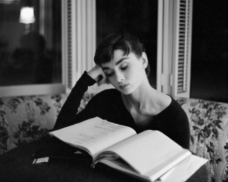 "I think people like to post this picture and pretend it enhances Hepburn's aura of perfection –– ""she reads!  she's smart!"" –– but if you look closely, you'll see she's just perusing a script."